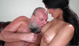 Pretty brunette with big naturals copulates an padre