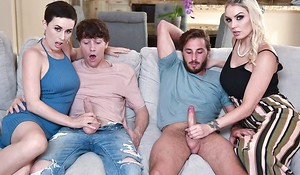 Two slutty MILFs swap their sons and get fucked just about the humming room