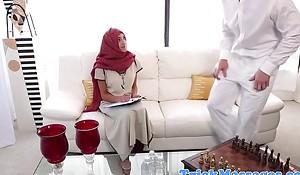 Hijabi tot massaged on blustery spots